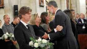 David Robinson junto al Rey en el funeral.