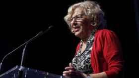 Manuela Carmena, durante la inauguración de un evento económico en Madrid este verano.