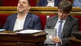 Oriol Junqueras y Carles Puigdemont, en el Parlamento autonómico catalán. Eran otros tiempos.