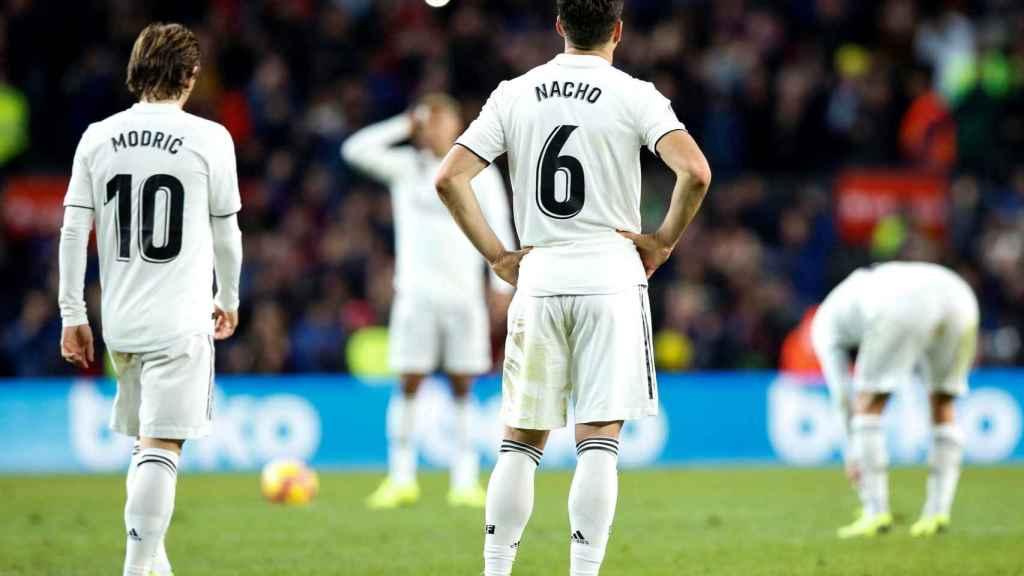 Nacho y Modric, abatidos tras caer en El Clásico