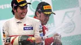 Sergio Pérez y Feranando Alonso el el podio del GP de Malasia 2012