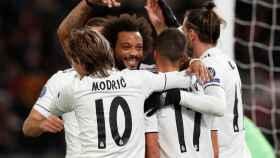 Los jugadores del Real Madrid celebran un gol ante la Roma en la Champions League