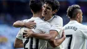 Marco Asensio y el defensa Jesús Vallejo, festejan el gol del primero durante el partido ante el Melilla