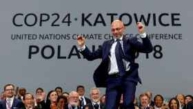 Michal Kurtyka, presidente de COP24,  reacciona con alegría en la conferencia en Katowice.