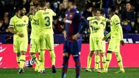 Messi, celebra uno de los goles.