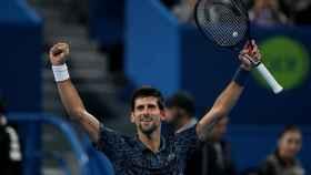 Novak Djokovic celebra su victoria en Doha