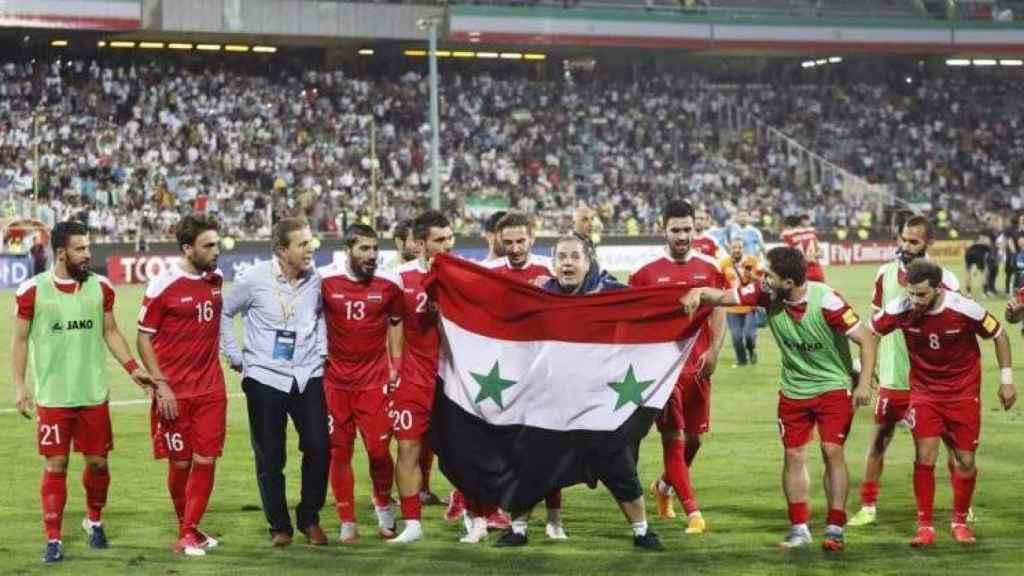 La selección de Siria celebra una victoria en Teherán