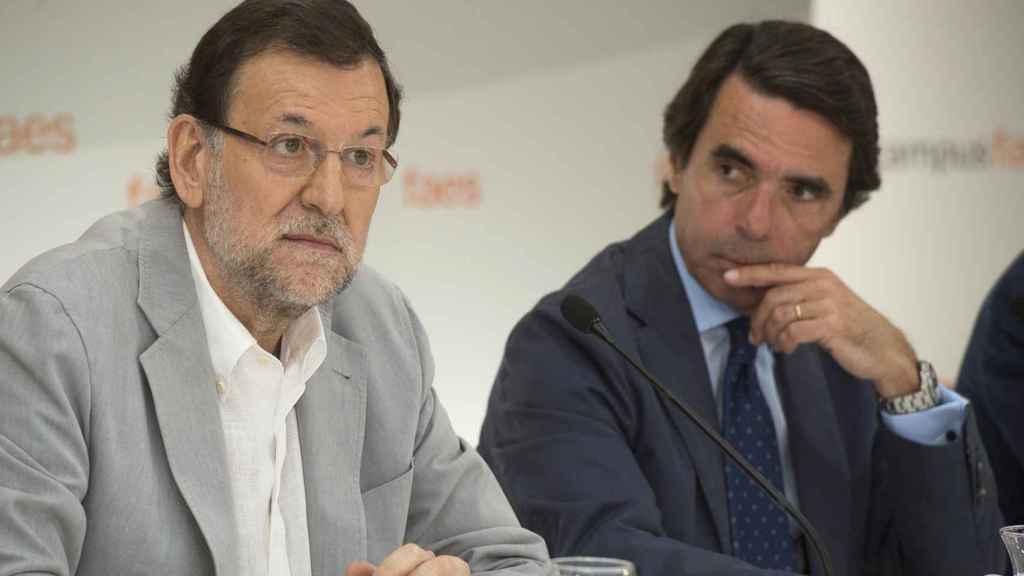Mariano Rajoy y José María Aznar en 2013.