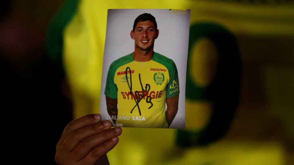 A fan holds a portrait of Emiliano Sala in Nantes' city center after news that newly-signed Cardiff City soccer player Emiliano Sala was missing after the light aircraft he was travelling in disappeared between France and England