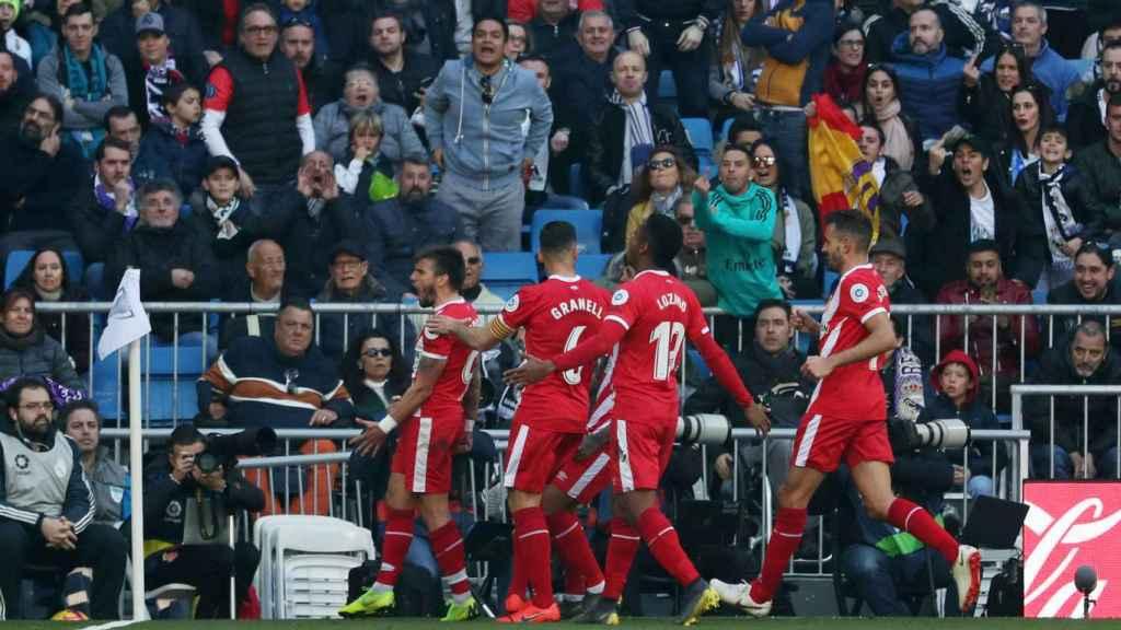 Portu celebra con los jugadores del Girona su gol al Madrid