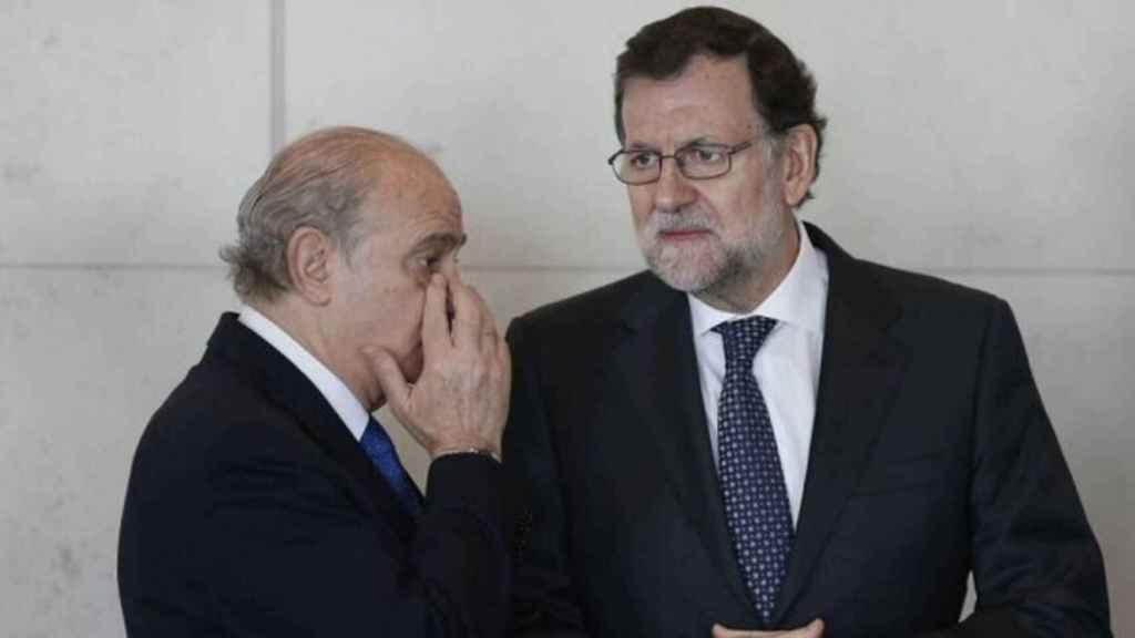 Jorge Fernández Díaz y Mariano Rajoy, en una imagen de archivo.