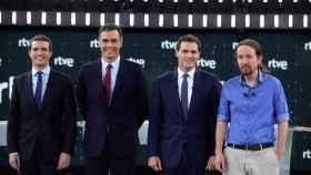 Los candidatos a la presidencia del Gobierno Casado, Sánchez, Rivera e Iglesias, este lunes.