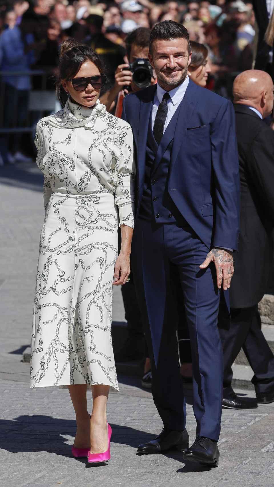 Victoria y David Beckham han llegado en mitad de una gran ovación sevillana.