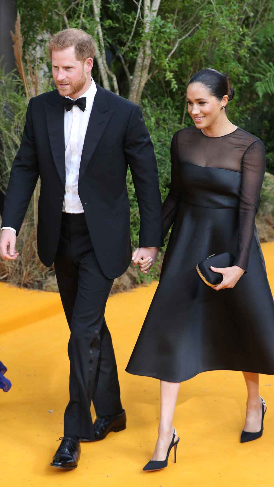 Harry de Inglaterra y Meghan Markle en el estreno de 'El Rey León'.