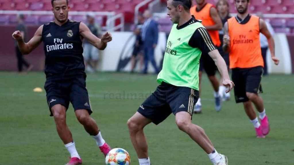Lucas Vázquez y Gareth Bale durante el último entrenamiento del Real Madrid.