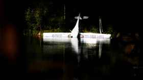 Norway's first battery-powered aircraft piloted by Avinor Chief Executive Dag Falk-Petersen is seen partly submerged in a lake after crash-landing, in Nornestjonn, Arendal