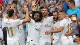 Los jugadores del Real Madrid celebran el gol de Benzema ante el Valladolid