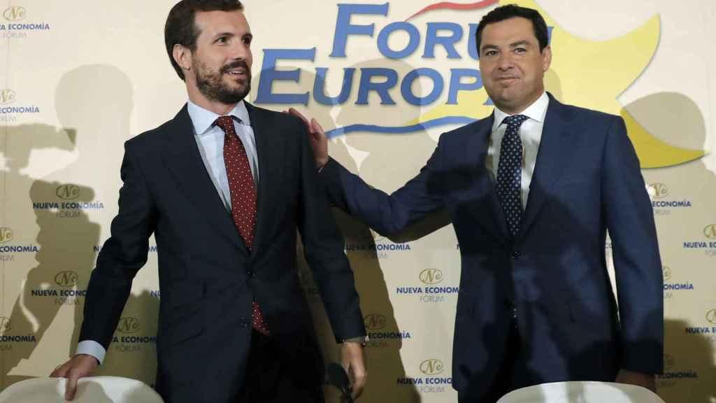 El presidente de la Junta de Andalucía, Juan Manuel Moreno Bonilla, interviene en un desayuno informativo este lunes, junto con el líder del PP, Pablo Casado .
