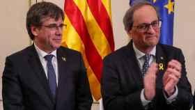 Carles Puigdemont, expresidente de la Generalitat junto a Quim Torra, actual presidente de la Generalitat.