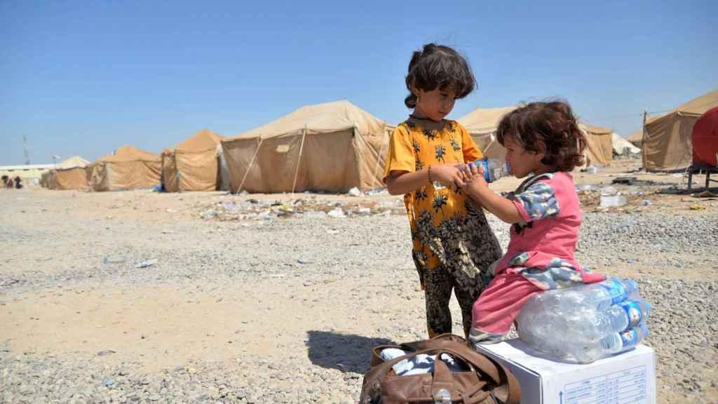 Niños en un campo de refugiados