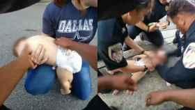 Imágenes del vídeo que muestran cómo los policías reanimaron al bebé