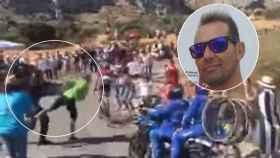 Instante en el que Diego Jesús Flor recibe el empujón de un guardia civil mientras él, a una distancia de unos tres metros, animaba al ciclista Alberto Contador.