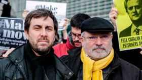 Toni Comín y Lluís Puig en un acto independentista.