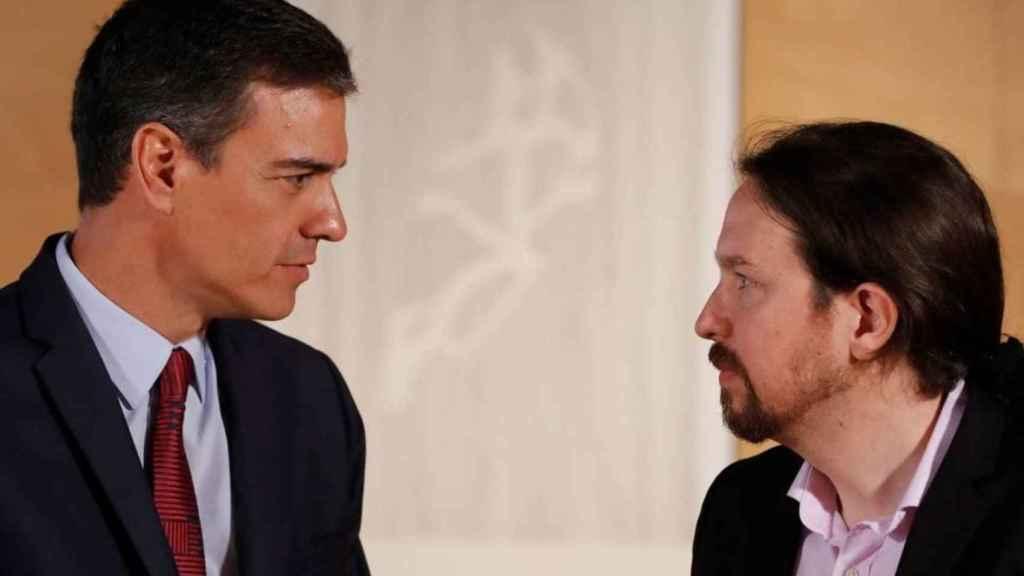 El presidente de Gobierno, Pedro Sánchez, con su socio Pablo Iglesias.