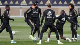Los jugadores del Real Madrid, durante el entrenamiento