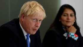 Boris Johnson y la ministra de Interior, Pitri Patel.
