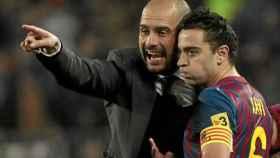 Pep Guardiola y Xavi, en el Barcelona