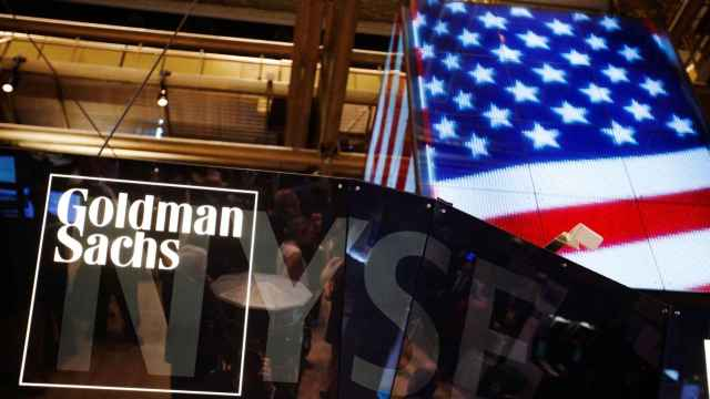 FILE PHOTO: The Goldman Sachs logo is displayed on a post above the floor of the New York Stock Exchange