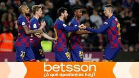 Leo Messi celebra un gol con el resto de sus compañeros