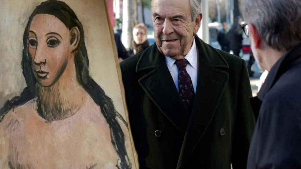 El cuadro 'Cabeza de mujer joven' de Picasso y el expresidente de Bankinter, Jaime Botín.