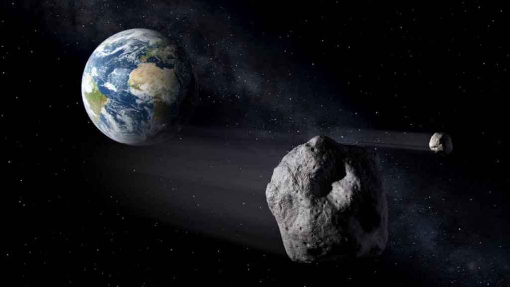 Representación artística de asteroides pasando cerca de la Tierra