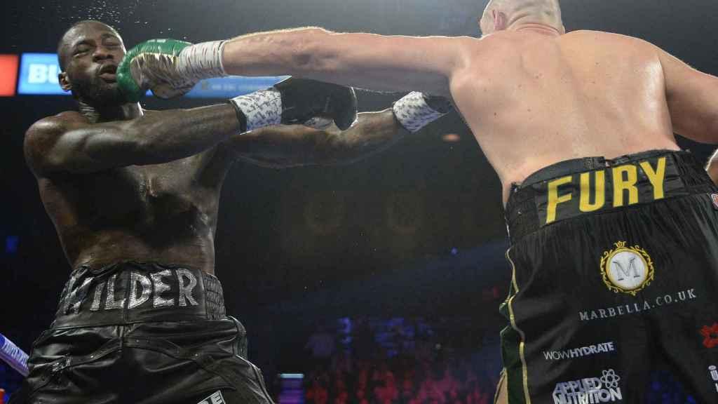 Fury y Wilder durante el combate