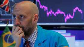 Specialist trader works at his post on the floor at the NYSE in New York