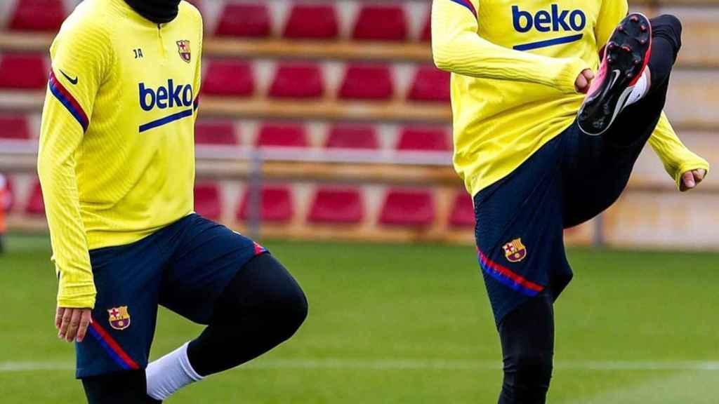 Jordi Alba y Gerard Piqué, durante el entrenamiento