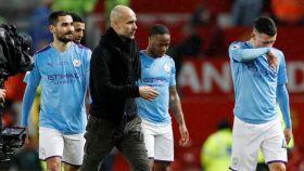 Pep Guardiola, Ilkay Gundogan, Raheem Sterling y John Stones, durante un partido del Manchester City
