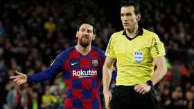 Leo Messi y Martínez Munuera