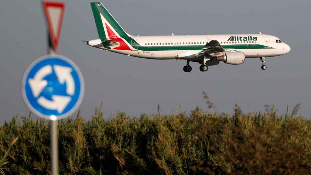 FILE PHOTO: An Alitalia Airbus A320 airplane approaches to land at Fiumicino airport in Rome, Italy