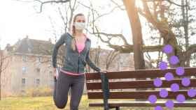 Una mujer haciendo estiramientos antes de empezar a correr.