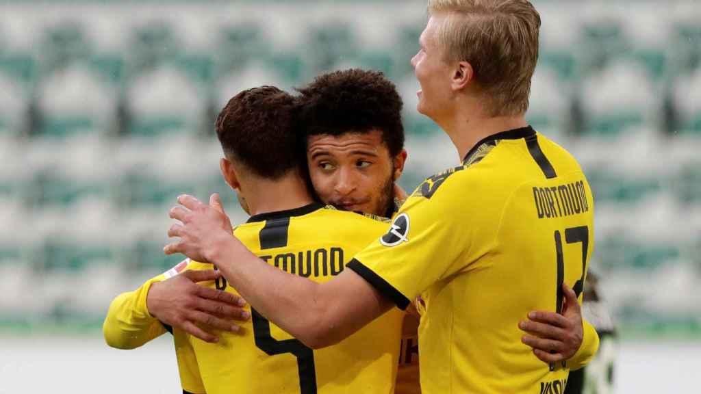 Achraf, Haaland y Jadon Sancho celebran el gol del marroquí