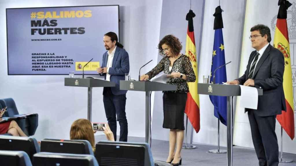 Pablo Iglesias, María Jesús Montero y José Luis Escrivá.