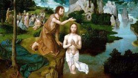 San Juan Bautista bautizando a Cristo en el río Jordán.