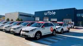 Coches de WiBLE aparcados.