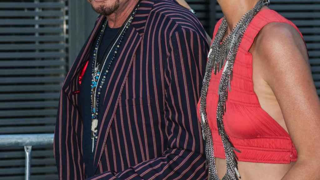 Johnny Hallyday y su esposa Laeticia en 2013.
