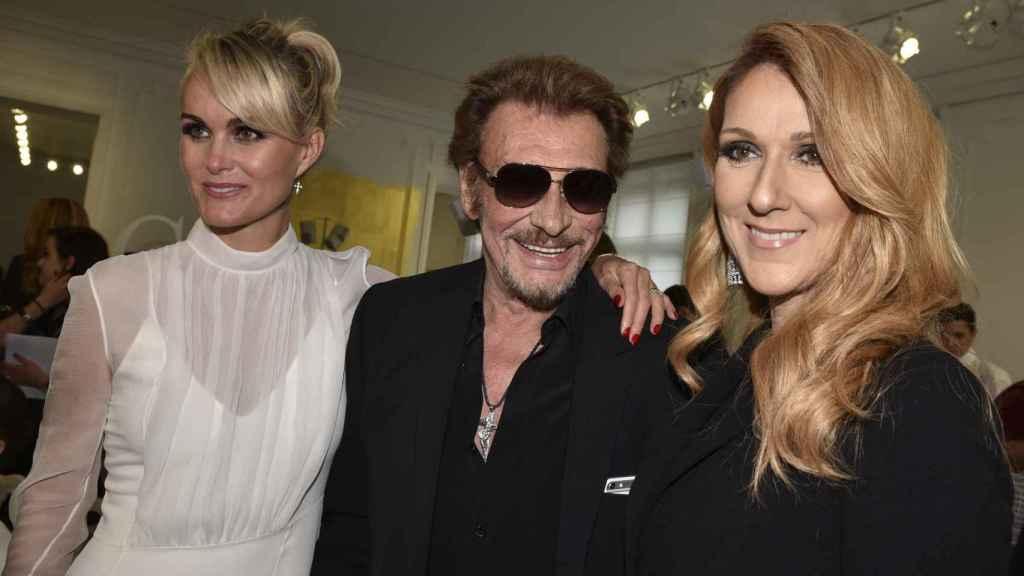 Johnny Hallyday junto a su mujer Laeticia y la cantante Celine Dion.