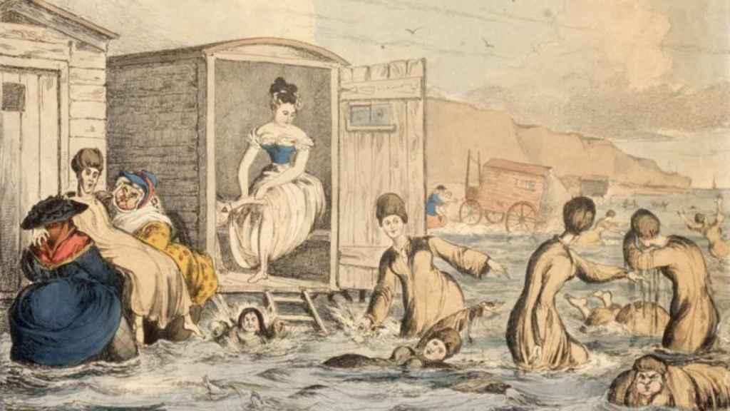 Ilustración de unas mujeres bañándose en el siglo XIX que muestra los carros con los que accedían a la playa.