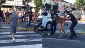 La mujer que provocó el siniestro, detenida por agentes de la policía.